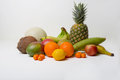 Tropical fruits a grocery of fresh a pineapple coconut honey dew bananas oranges kumquats lemon mangos apples and plantains Royalty Free Stock Images