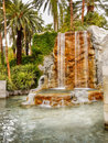 Tropical Garden, Waterfall, Lake, Palms Royalty Free Stock Photo