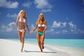 Tropical girls run Royalty Free Stock Image