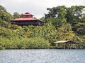 Tropical house with boathouse coastal home garden and a over water panama caribbean sea Royalty Free Stock Photos