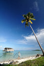 Tropical island with clear blue sky and tourist Royalty Free Stock Image