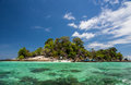 Tropical island with clear water and blue sky lipe thailand skies Royalty Free Stock Images
