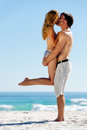 Tropical island couple kiss Royalty Free Stock Images