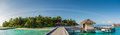 Tropical island harbor panorama view with palm trees at Maldives Royalty Free Stock Photo