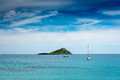 Tropical island landscape of a small and sailboats under cloudscape at greece Stock Photography