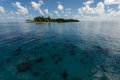 Tropical island rises above coral reef in hol chan marine reserve belize tiny the Royalty Free Stock Image