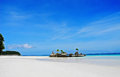 Tropical island is on a white sand beach with blue sky and white cloud Stock Photography