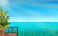 Tropical landscape with blue sea and palm trees Royalty Free Stock Photo