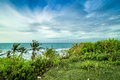 Tropical landscape on the cliff of Balangan beach, Bali, Indonesia, Asia. Sunny day, beautiful blue sky, green palms. Royalty Free Stock Photo