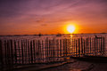 Tropical landscape at sunset. The fence and the sea. White beach. Boracay. Philippines.