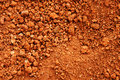 Tropical laterite soil red earth background Royalty Free Stock Photo