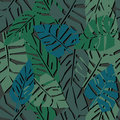Tropical leaves seamless pattern on dark background. green palm leaves background.