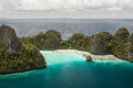 Tropical limestone islands rugged surround a gorgeous lagoon in raja ampat indonesia this remote island group is known as wayag Royalty Free Stock Images