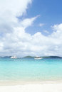 Tropical ocean and beach caribbean with islands yachts in the background clear water white sand Stock Photos