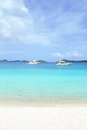 Tropical ocean white sand beach caribbean with islands and yachts in the background clear water and Stock Image