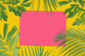 Tropical palm leaves with empty paper for your design on yellow