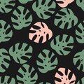 Tropical palm and monstera leaves seamless pattern