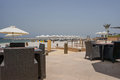 Tropical Paradise. Beach with sun loungers and parasols in Dubai, on the Persian Gulf. The Emirate of RAS al Khaimah. Tinted