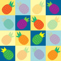 Tropical pinapples in vibrant colors angled on blue yellow squares pattern