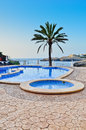 Tropical pool view a looking out over the mediterranean sea Royalty Free Stock Photo