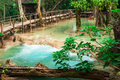 Tropical rain forest jangles with kuang si cascade waterfall lu jangle landscape of landscape wooden bridge and amazing turquoise Stock Photography