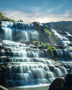 Tropical rain forest landscape with flowing blue water of pongou pongour waterfall at sunny day under sky da lat vietnam Royalty Free Stock Image
