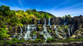 Tropical rainforest landscape panorama with flowing pongour wate waterfall under blue sky da lat vietnam Royalty Free Stock Photography