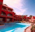 Tropical resort beautiful red hotel with a swimming pool in egypt Royalty Free Stock Image
