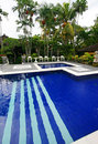 Tropical resort hotel swimming pool Royalty Free Stock Photo