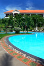 Tropical resort with swimming pool Stock Images