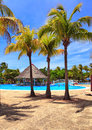 Tropical resort at swimming pool Royalty Free Stock Image
