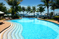 Tropical resort with swimming pool beautiful at luxury Royalty Free Stock Photo