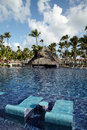 Tropical resort swimming pool in punta cana dominican republic Royalty Free Stock Photography