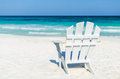 Tropical resort view with beach chair over turquoise sea at exotic sandy beach Royalty Free Stock Photo