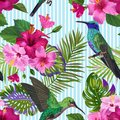 Tropical Seamless Pattern with Hummingbirds, Hibisсus Flowers and Palm Leaves. Floral Background with Birds for Fabric