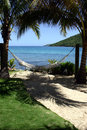 Tropical seaside hammock Stock Photo
