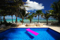 Tropical seaside pool Royalty Free Stock Photo