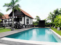 Tropical style house with pool and landscaping Royalty Free Stock Photos