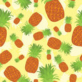 Tropical summer seamless pattern of pineapples on yellow background