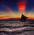 Tropical sunset with sailboat boracay philippines Royalty Free Stock Photo