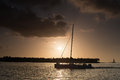 Tropical sunset and sailboat with silhouette of Royalty Free Stock Images