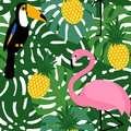 Tropical trendy seamless pattern with pink flamingos, toucans, pineapples and green palm leaves.