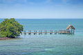 Tropical under sea ocean reef thatched hut boardwalk Stock Photo