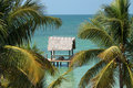 Tropical under sea ocean reef thatched hut boardwalk Royalty Free Stock Image