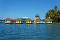 Tropical vacation bungalows over water Royalty Free Stock Photography
