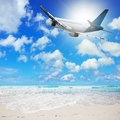 Tropical vacation concept jet plane over the beach Royalty Free Stock Image