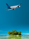 Tropical vacation jet plane over the beach Royalty Free Stock Photos