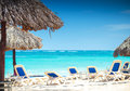 Tropical view of a beach with umbrellas and  beach chairs Stock Photos