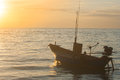 Tropical view of sea and fishing boats with sunset light at Chao Lao Beach.