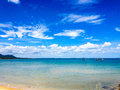 Tropical waters fishing boats and blue sky with white clouds thailand Stock Image